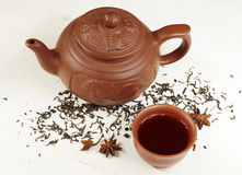 Clay teapot, bowl, tea and star anise Royalty Free Stock Photo