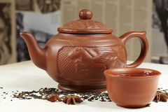 Clay teapot, bowl, tea and star anise Stock Photography