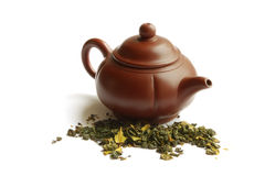 Clay teapot for the Chinese tea. And green tea, on a white background Royalty Free Stock Image