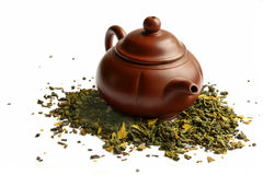 Clay teapot for the Chinese tea. And green tea, on a white background Royalty Free Stock Photography