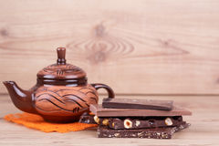 Clay teapot with chocolate Stock Image