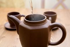 Clay teapot and cups Royalty Free Stock Photos