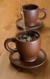 Clay teapot and cups Royalty Free Stock Photography