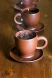 Clay teapot and cups Royalty Free Stock Image