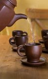 Clay teapot and cups Royalty Free Stock Images