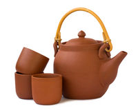 Clay teapot with cups isolated Stock Images