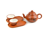 Clay teapot with cups Stock Photo