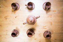 Clay teapot and cups on table Royalty Free Stock Photo