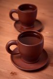 Clay teapot and cups on table Stock Image
