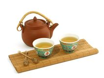 Clay teapot and cups of tea isolated on white Royalty Free Stock Photos