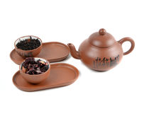Clay teapot and cups with tea Stock Photo