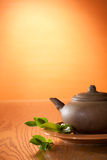 Clay teapot with greean tea Stock Image