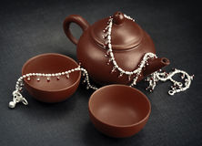 Clay teapot set and silver Royalty Free Stock Image