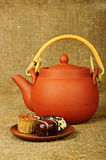 Clay teapot with sweets Stock Photography
