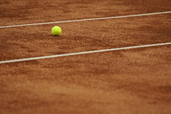 Clay tennis court with ball Royalty Free Stock Image