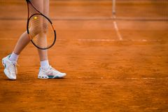 Clay tennis court and player concept. Clay tennis court with Tennis player legs Royalty Free Stock Photos