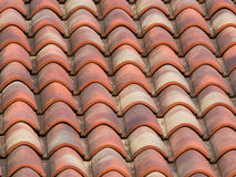 Clay (terracotta) tiles on the roof of a country house Royalty Free Stock Photo