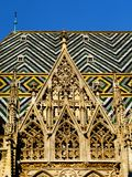 Clay tile church roof detail under blue sky stock photography