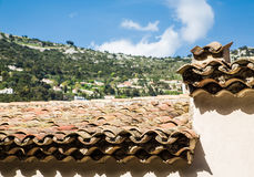 Clay Tile Pipe Roof and White Paster Walls Royalty Free Stock Images