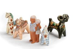 Clay toys 4. Two clay rams, two clay horses, clay girl and clay boy stock photos