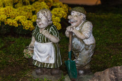 Clay uncle and aunt Gardener in garden Stock Images