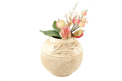 Clay vase. Decorative flowers in a clay round vase Stock Photo