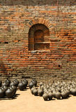 Clay vases kept for drying with brick wall Royalty Free Stock Photography