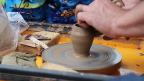 The clay vessel created via the electric potter machine by hand. stock video footage