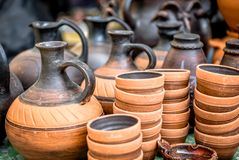 Clay ware . Clay ware for sale clay cookware on sale. The clay holds nutrients and keeps your food moist royalty free stock images