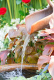 Clay Water Feature With Pond. Close Up Of Clay Water Feature With Pond royalty free stock photos