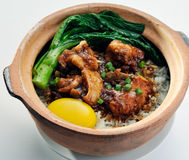 Claypot chicken rice with soy sauce vegetable Stock Photos
