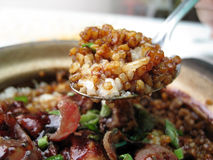 Claypot rice. A scoop of rice with delicious soya sauce Stock Image