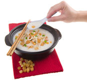 Claypot traditional chinese scallop porridge Royalty Free Stock Photography
