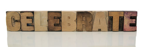 Célébrez dans le type en bois d'impression typographique Photo stock