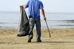 Clean. Environmental pollution -cleaning the beach early in the morning Stock Image