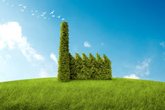 Clean air. Industrial building with the form of a bush for the environmental topic Stock Photos