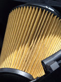 Clean Air. Paper element of air cleaner filter in automobile internal combustion engine stock photography