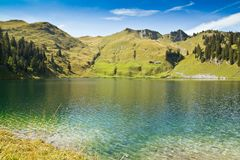 Clean alpine lake in summer Royalty Free Stock Photos