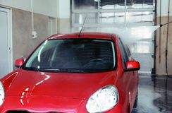 Clean automobile at car wash service. Clean automobile at professional car wash service royalty free stock image