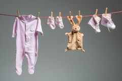 Clean baby girl clothes on the clothesline Royalty Free Stock Photo