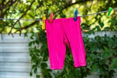 Clean baby pants on the outdoor clothesline stock photography