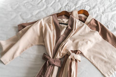 Clean bathrobe  on bed . Stock Images
