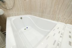 Clean bathroom bath , bathtub , bathroom white hygiene clean style. Bath for small bathrooms.  stock photos