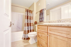 Clean bathroom with brown curtain Royalty Free Stock Image