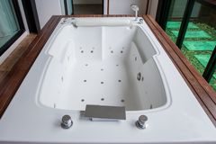 Clean bathroom modern bath , bathroom white hygiene clean modern style. Hotel real estate , luxury wellbeing style leisure and car. E. luxury jacuzzi bathtub royalty free stock photos