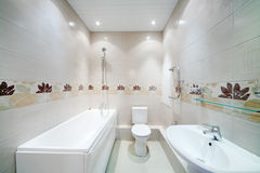 Clean bathroom with toilet with simple grey tiles. On walls in new apartment Stock Images