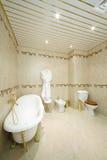 Clean bathroom with white bath, bathrobe, toilet and bidet Stock Photography