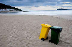 Clean beach and recycling bins. Royalty Free Stock Photography