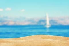 Clean beach sand sea and yacht. View from clean beach sand on sea and yacht Stock Image