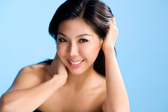 Clean and beautiful face of asian woman. Asian young woman of clean and refreshing beautiful face smiling sweet Royalty Free Stock Images
